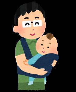 抱っこ紐で赤ちゃんを抱っこするお父さん